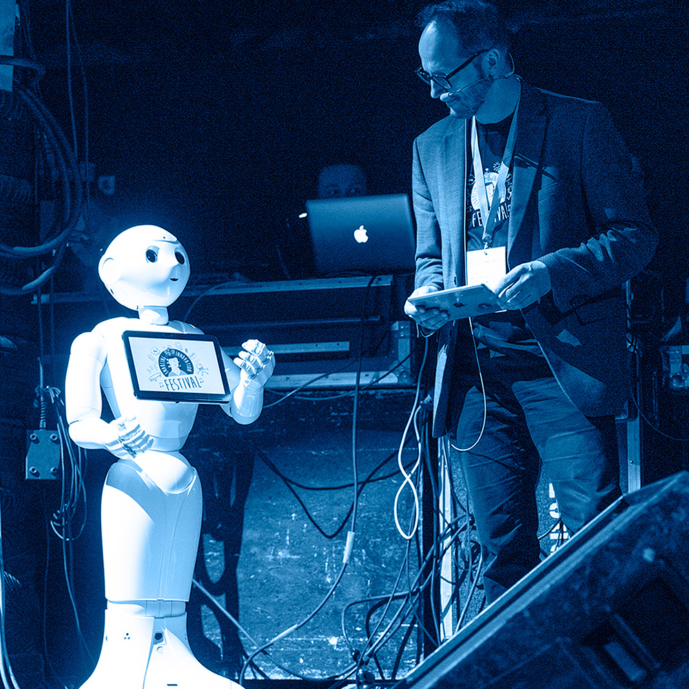 The moderator and robot will be on the stage of the Enabling Innovation Festival in Münster, 2019.