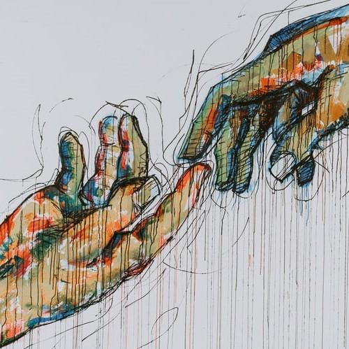 Zwei Hände, die sich berühren